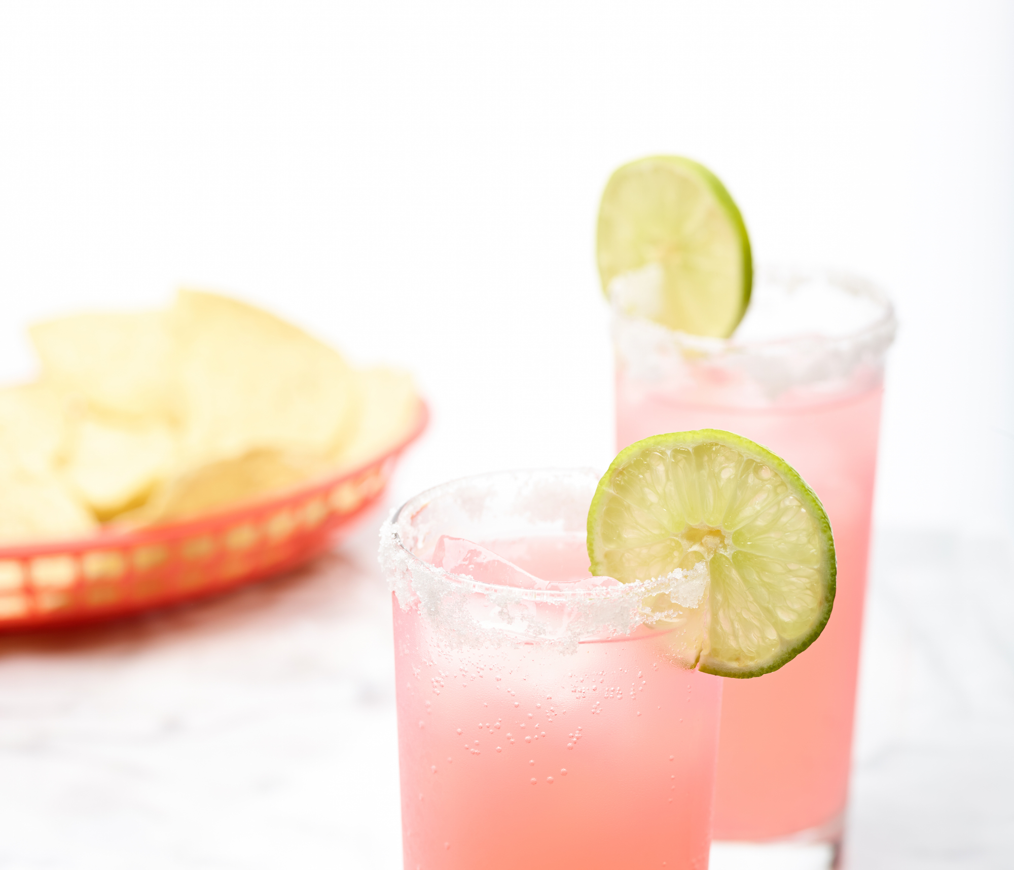 Rub the lime on the rim of a tall glass and salt the rim. image: felicia perretti