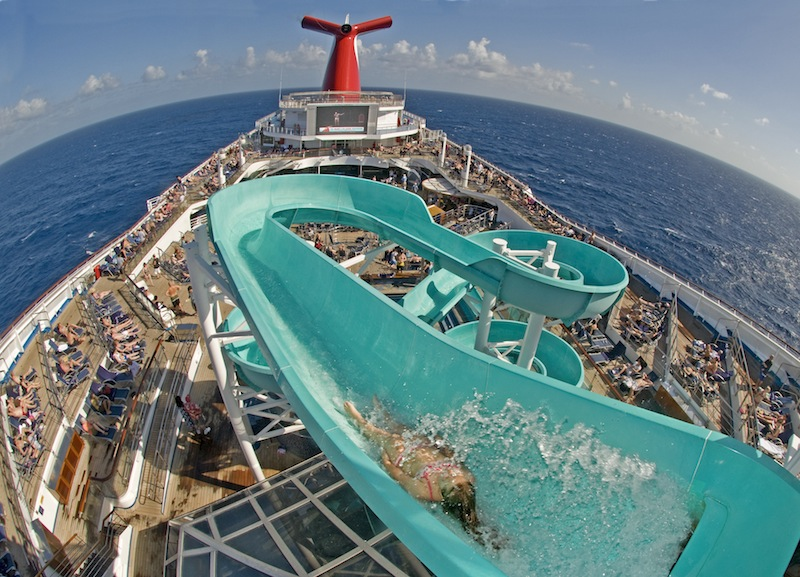 A guest begins her trip down Carnival Liberty's iconic water slide. image:  andy newman/carnival cruise lines