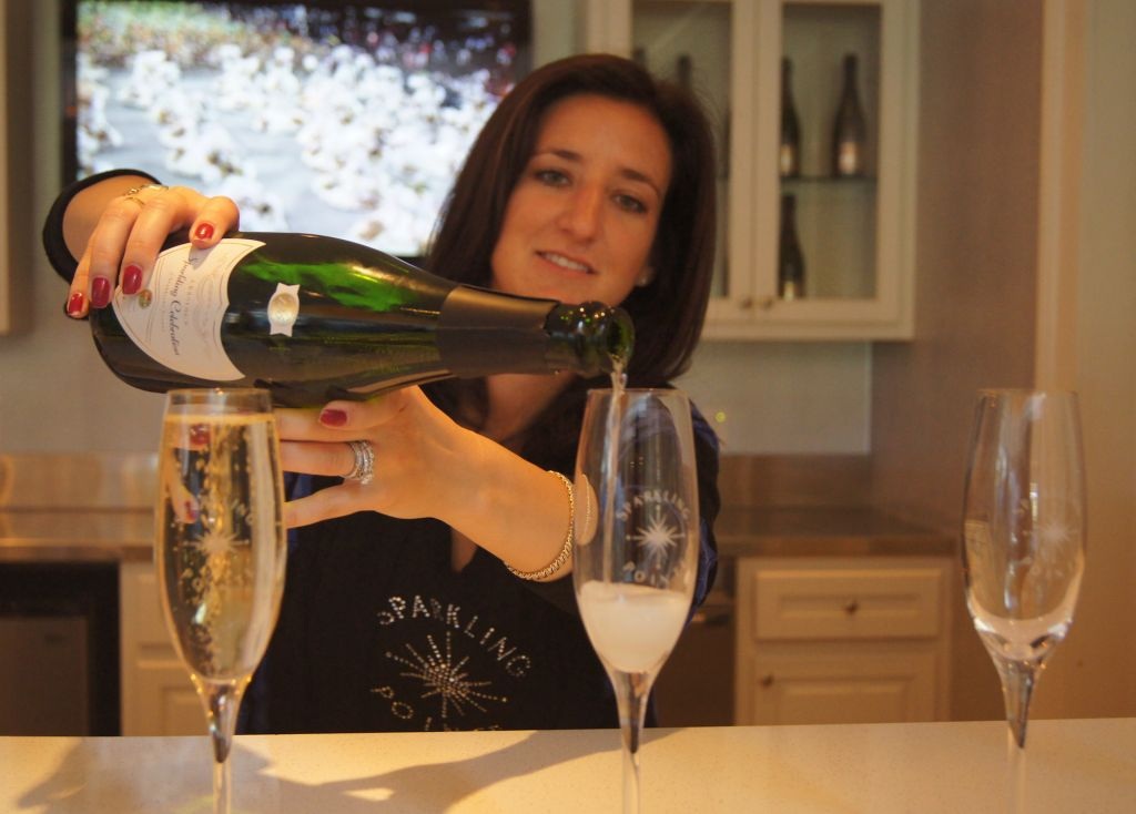 Laura Trunz Regional Sales Manager at Sparkling Pointe Vineyards pours a glass of Lessing's Sparkling Celebration. image: bridget shirvell