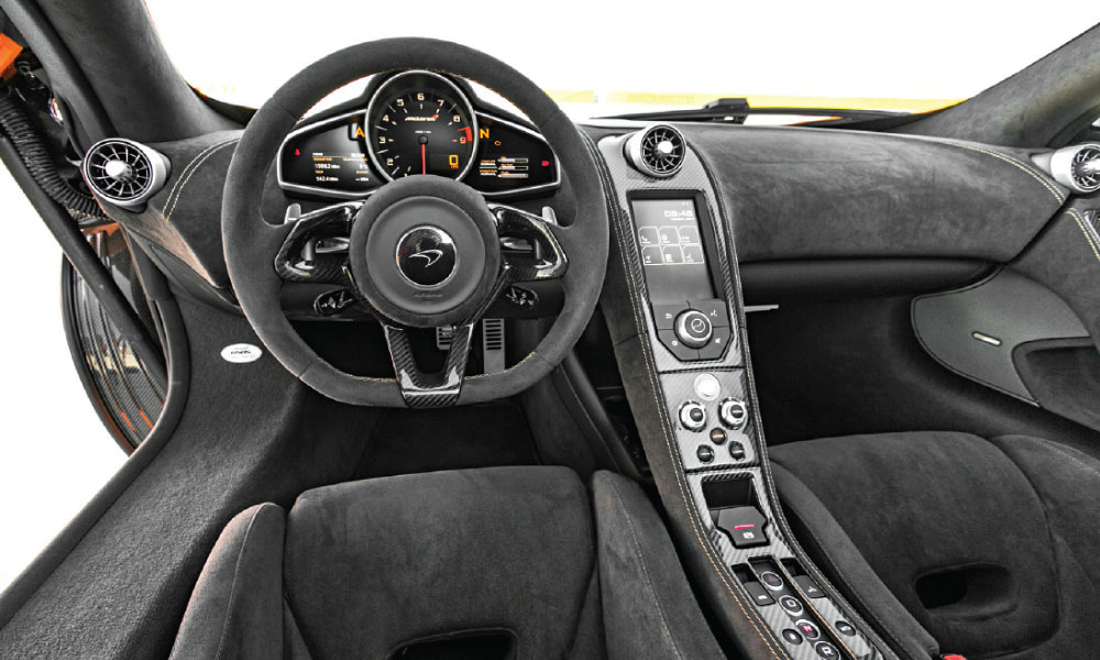The race-crafted steering wheel is smaller than most and bedecked with carbon-fiber inlays