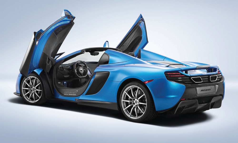 The vertically hinged doors of the spider rise in an elegant, succinct swoop to reveal the cabin interior. image: mclaren Automotive