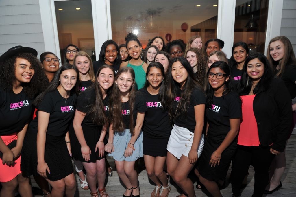 image: wfli executive director stacey scarpone, GirlsFLI program coordinator malisa ali and GirlsFLI girls