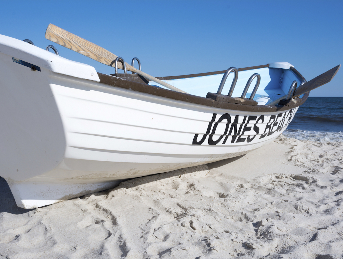 A boat docked offshore at Jones Beach on the south shore of Long Island. image: pm10