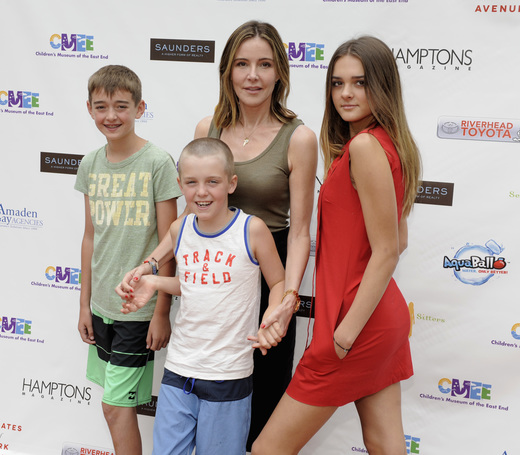 Honorary Chair Christa Miller and children Charlotte Sarah Lawrence, William Stoddard Lawrence and Henry Vanduzer Lawrence attend the Children's Museum of the East End's (CMEE) 7th Annual Family Fair at Childrens Museum of the East End on July 18, 2015 in Bridgehampton (credit: by matthew eisman/getty Images for CMEE)