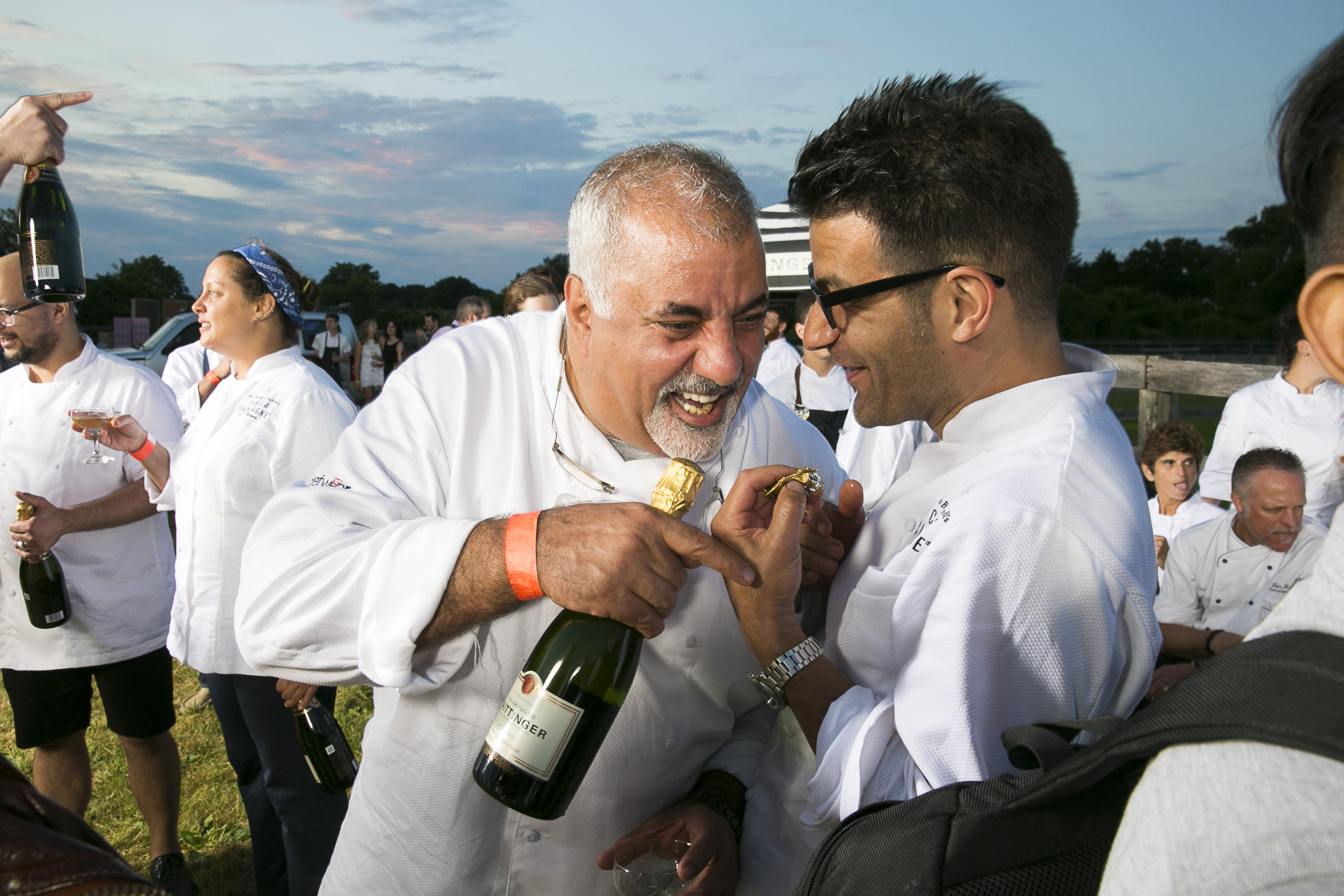 Chef Sam Hazen and Chef George Mendes seen at James Beard Foundation's Chefs & Champagne at Wolffer Estate on Saturday, July 25, 2015 in Sagaponack, N.Y. (credit: mark von holden/invision for james beard foundation/ap Images)