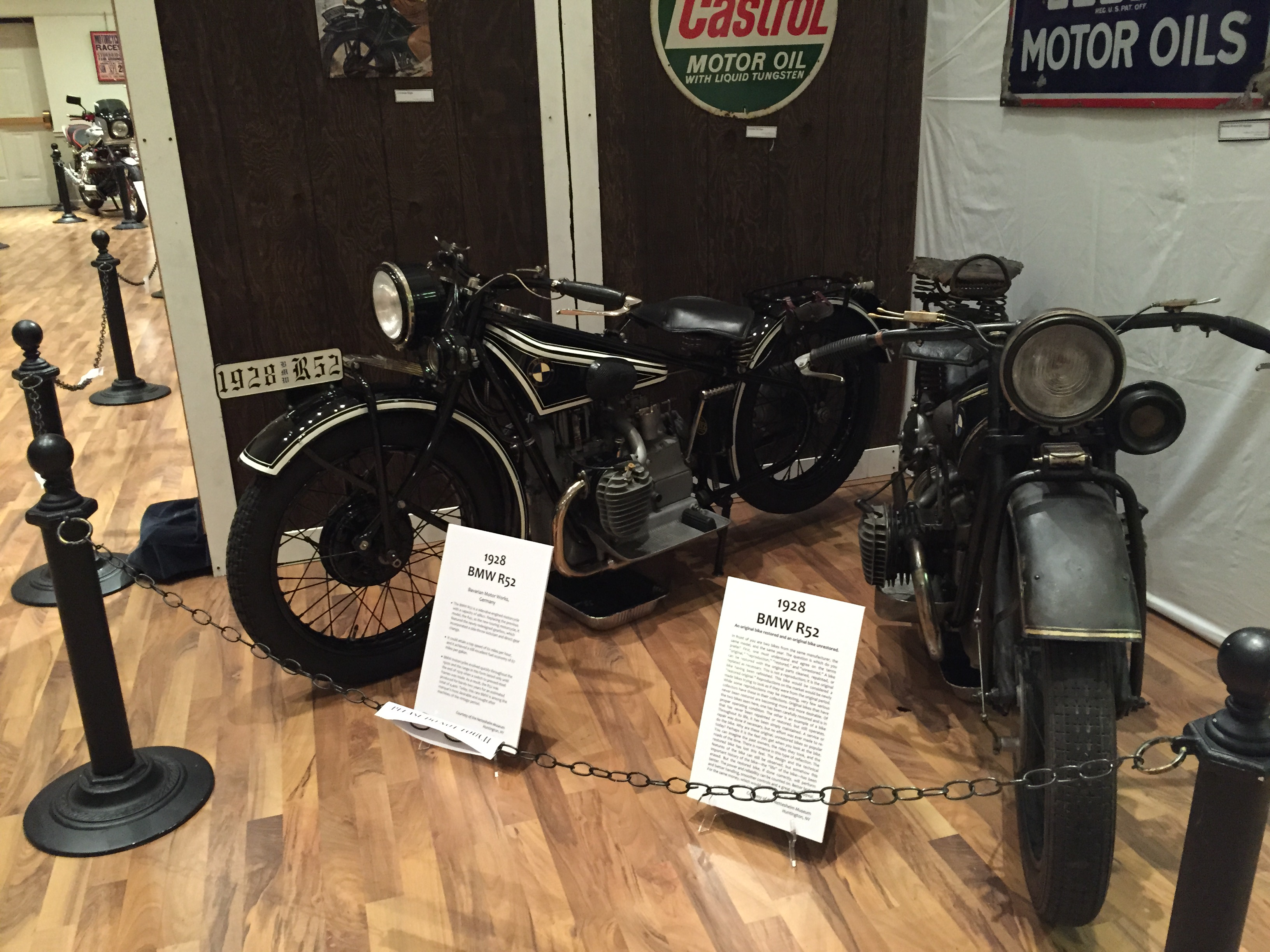 A restored and unrestored 1928 BMW R52 side by side at the WMHO Educational & Cultural Center