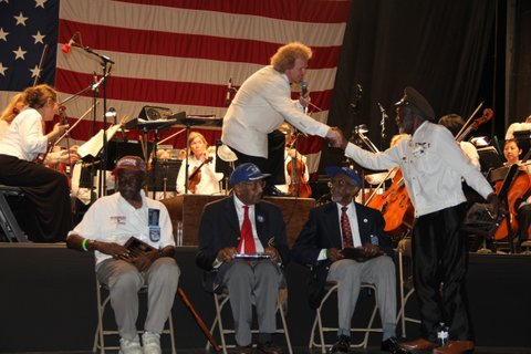 image: long island philharmonic conductor david stewart wiley with the tuskegee airmen in 2012 (credit: islip arts council)