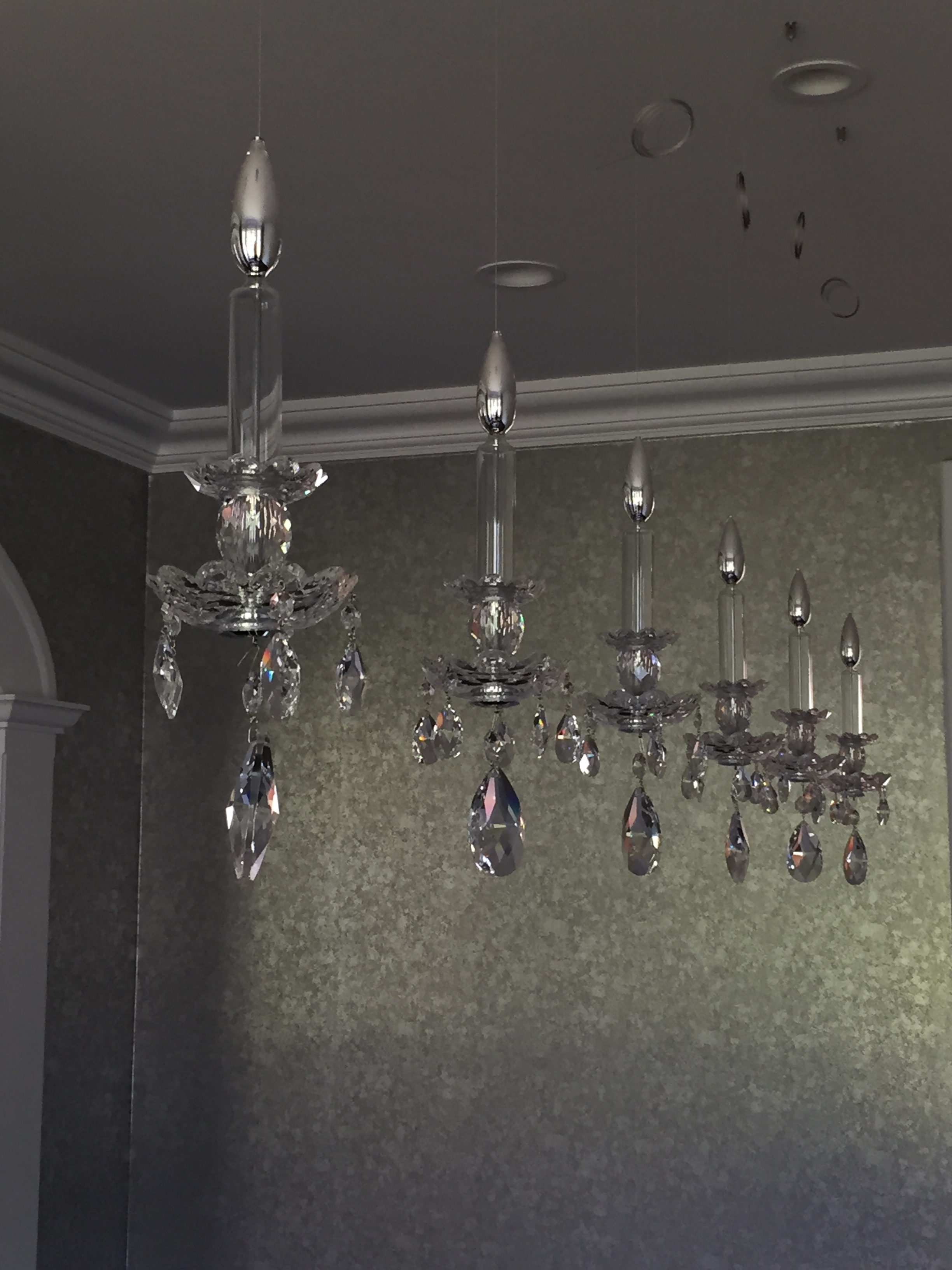 A linear chandelier is old school glamour with a modern twist (credit: AMi Designs)