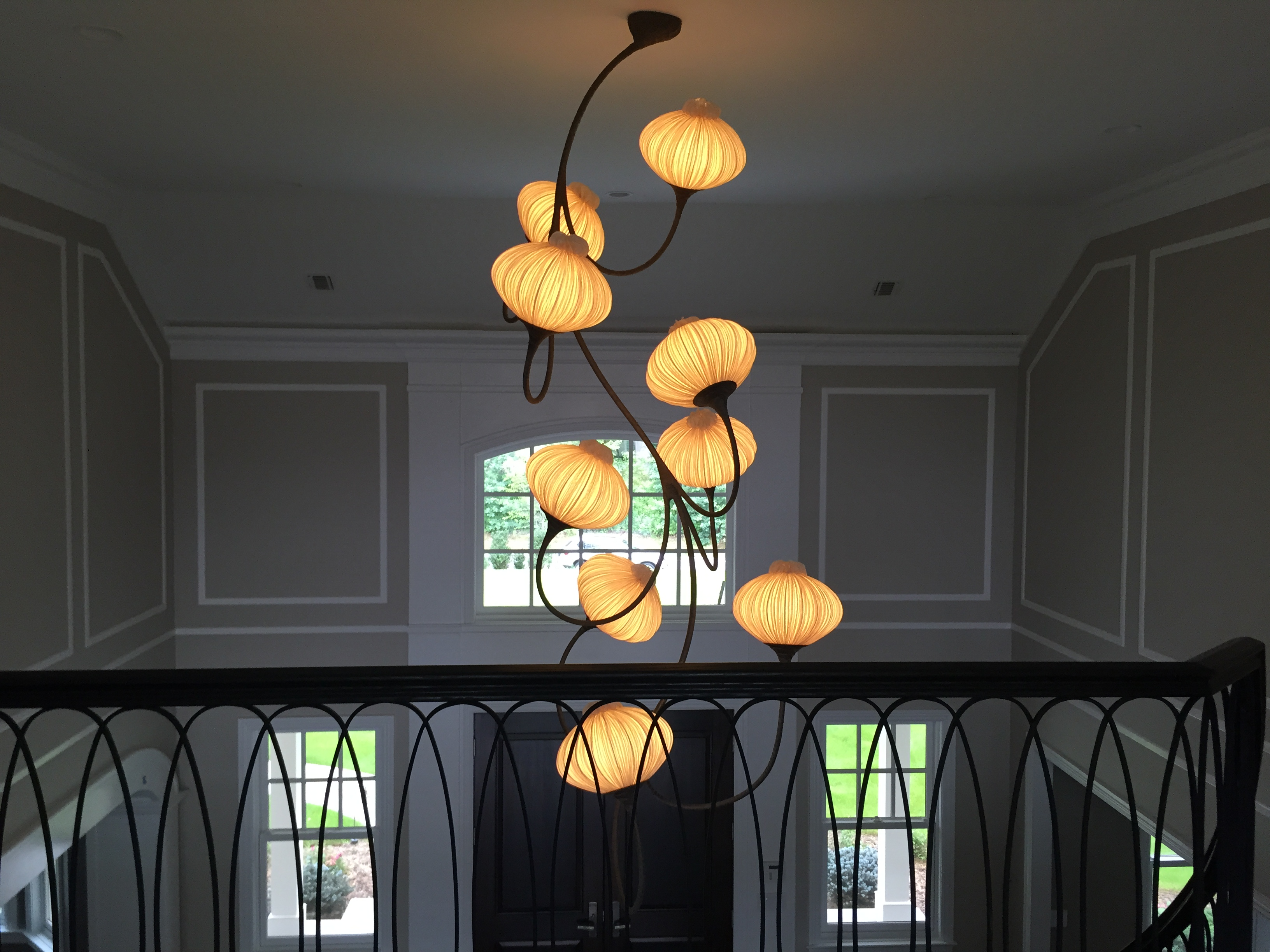 A sculptural light in an entryway brings the drama (credit: AMi Designs)