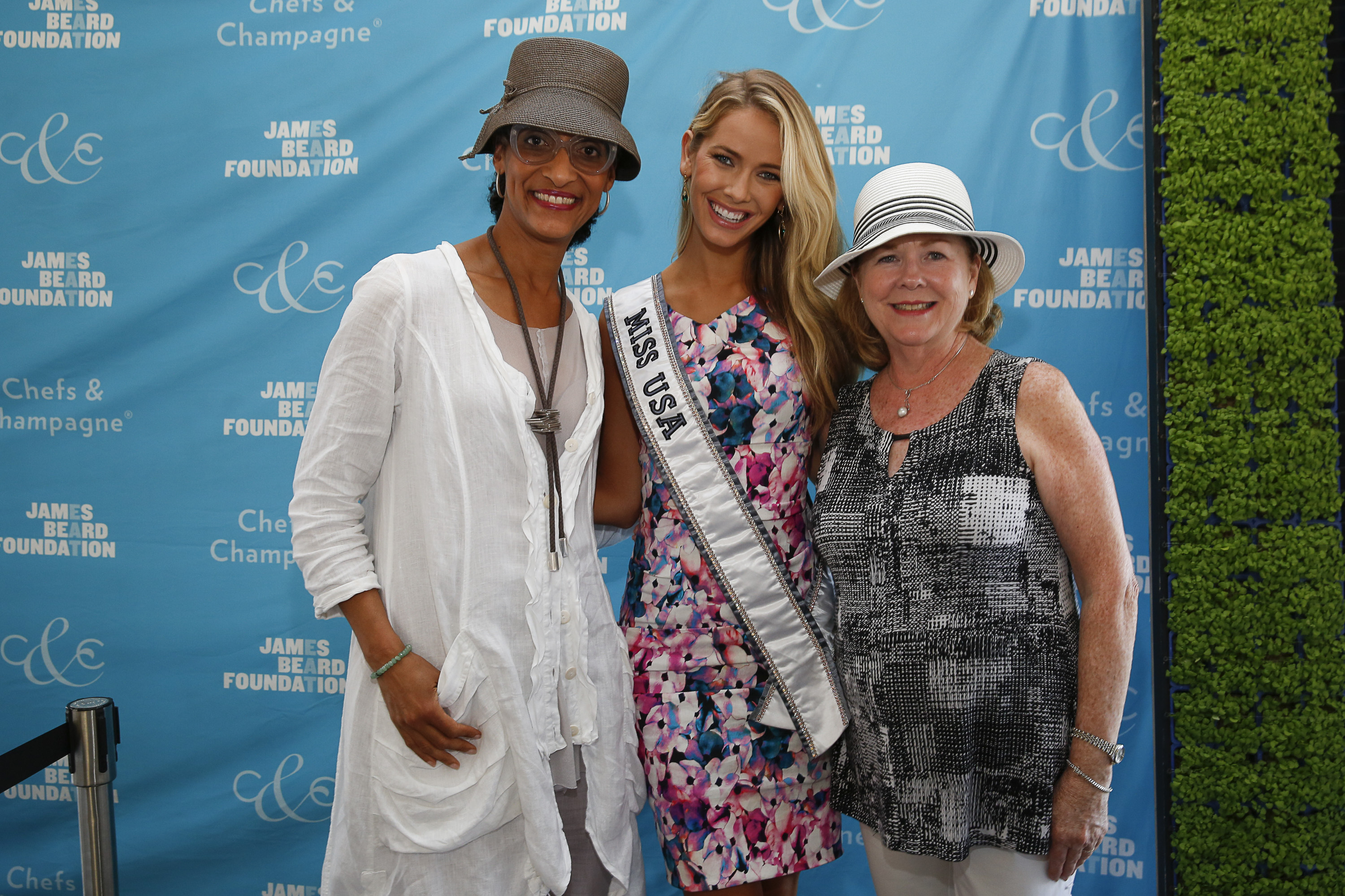 Honoree Chef Carla Hall, Miss USA Olivia Jordan and President of the James Beard Foundation Susan Ungaro seen at James Beard Foundation's Chefs & Champagne at Wolffer Estate on Saturday, July 25, 2015 in Sagaponack, N.Y. (credit: mark von holden/invision for james beard foundation/ap Images)