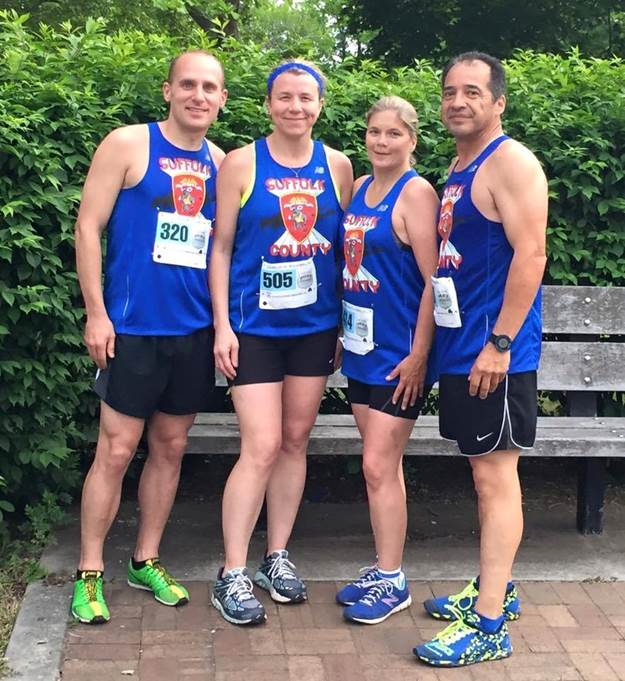 image: members of the Suffolk Police Running Club, including Josh Parsons of the Suffolk County Police Second Precinct;, Colleen Thompson of the Suffolk County Deputy Sheriffs, Dawn Testa of the New York State University Police Stony Brook and John Oakley of the Suffolk County Police Second Precinct