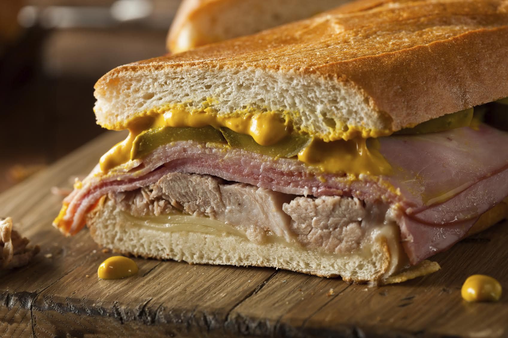 Homemade traditional cuban sandwiches with ham, pork and cheese