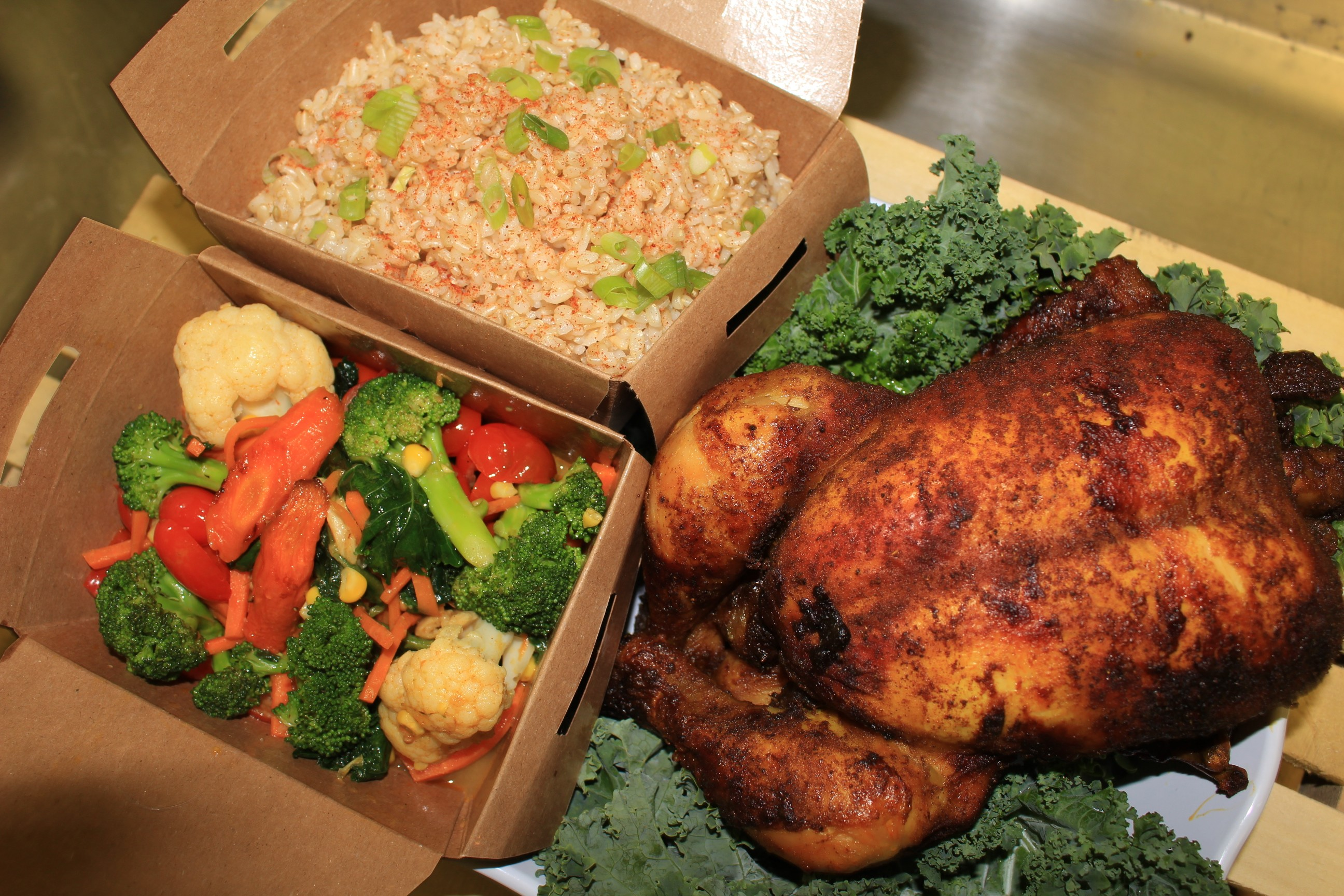 The menu at True Food & Juice Co. includes breakfast items like acai bowls, wraps and sandwiches for lunch, and even a whole spiced organic chicken ($16) as a dinner option.