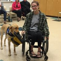 "Madyson Hess suffered a spinal chord injury in 7th grade. She and assistance dog Oxford ""click very well."""