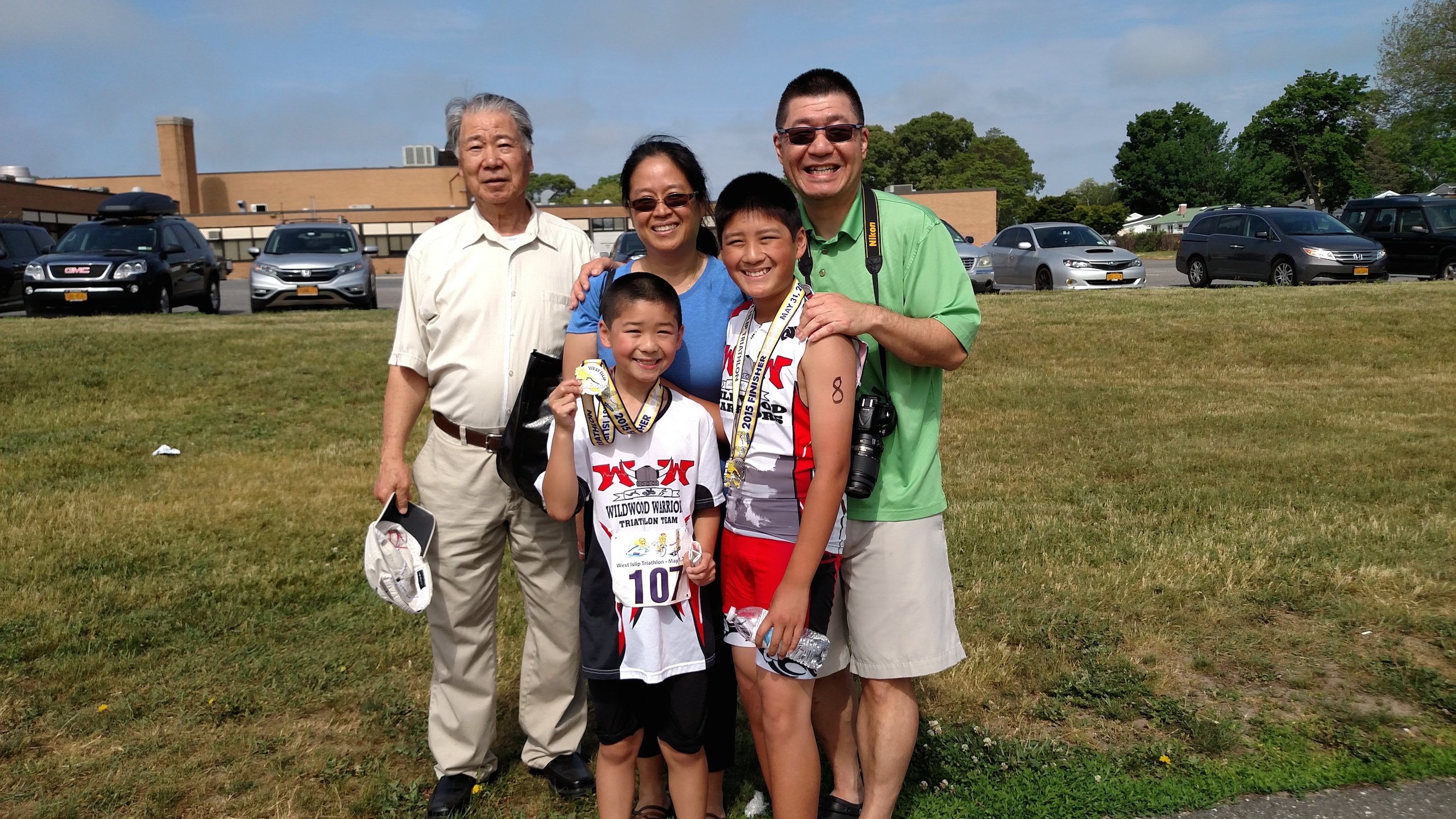 Lam with members of his family. Both of his sons run track and his wife is training for an iron man.