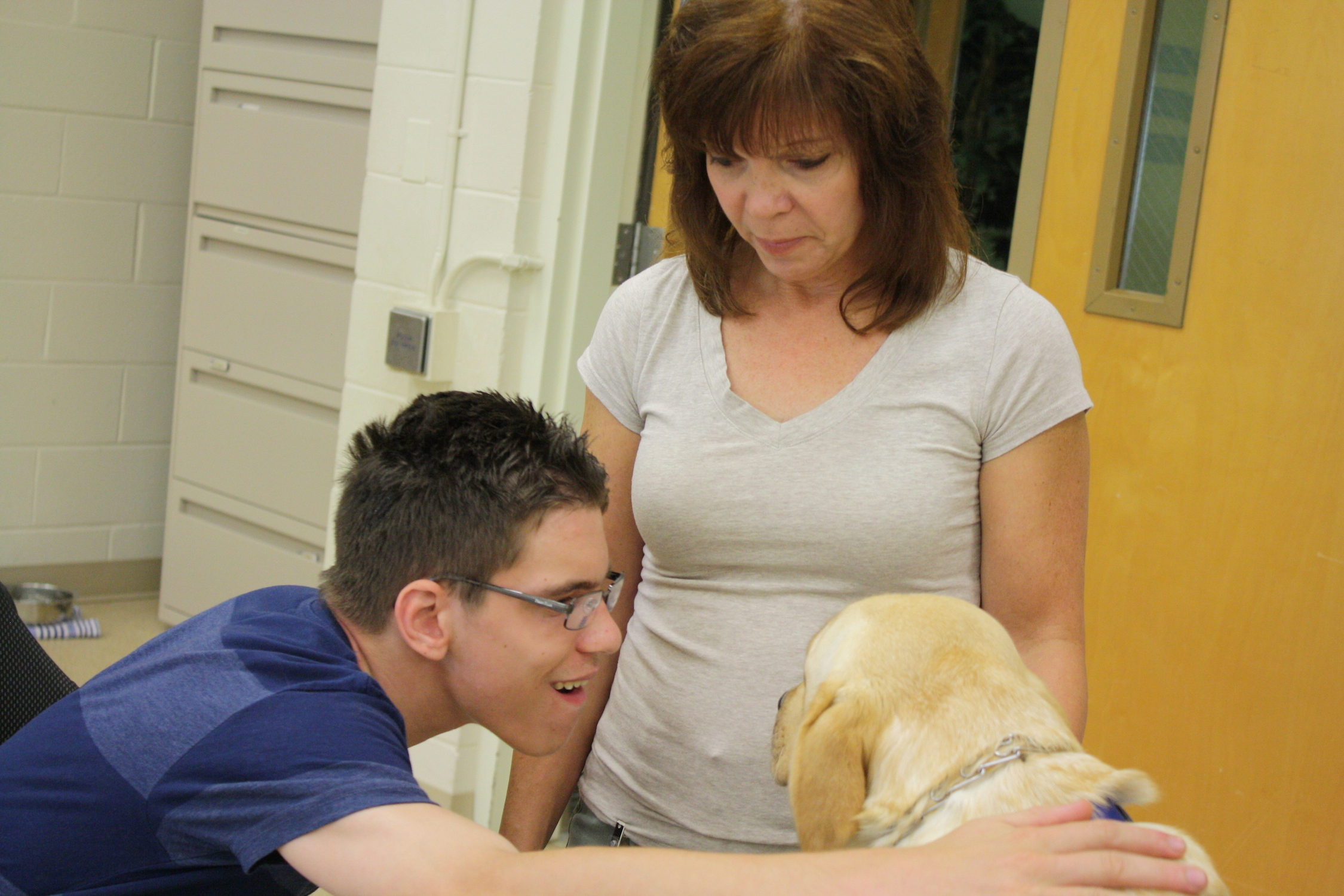 Sean and Lisa Egry with Honey during team training at the CCI campus in Medford.