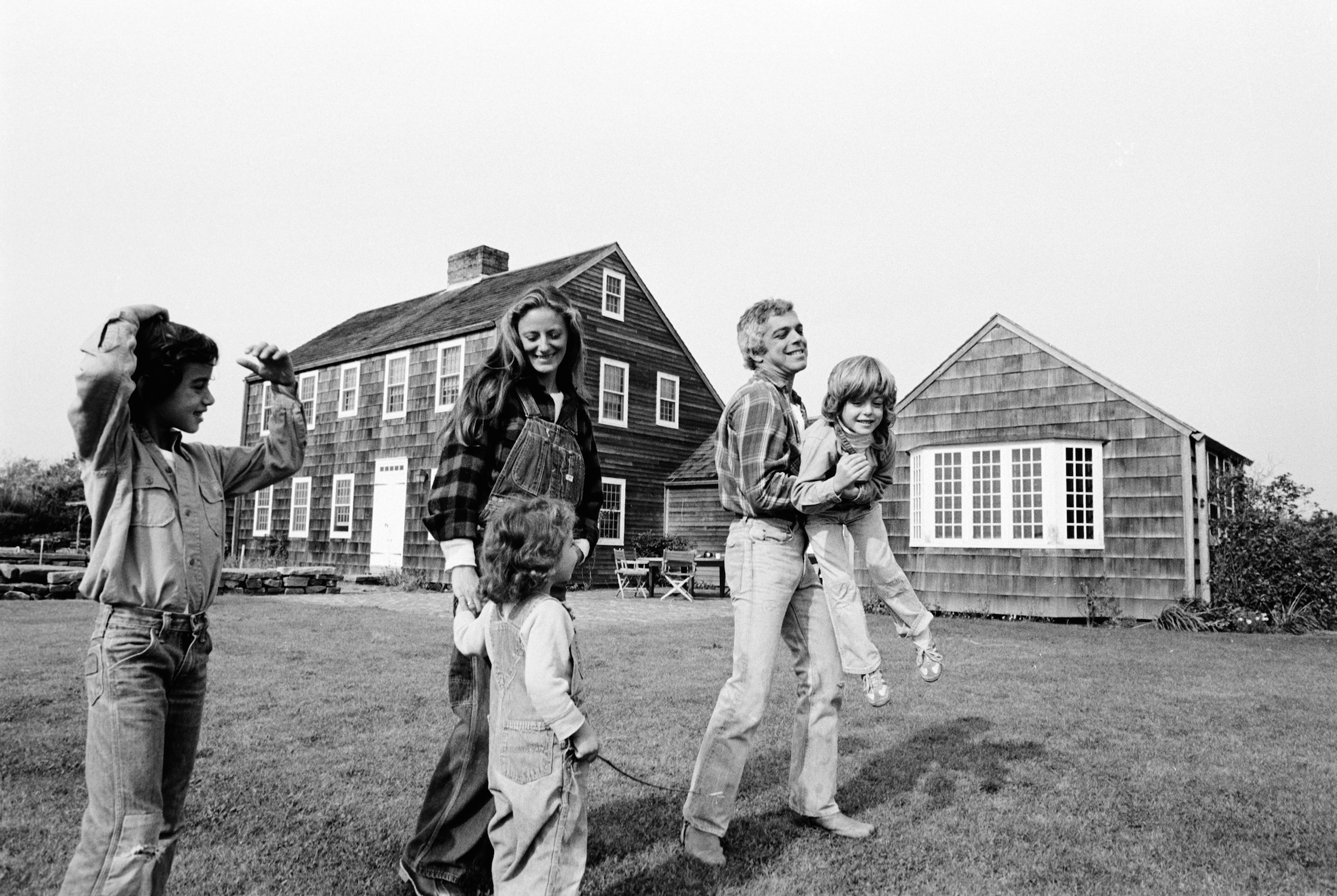 Ralph and Ricky Lauren photographed with their children David, Andrew and Dylan outside their East Hampton home. 1977.