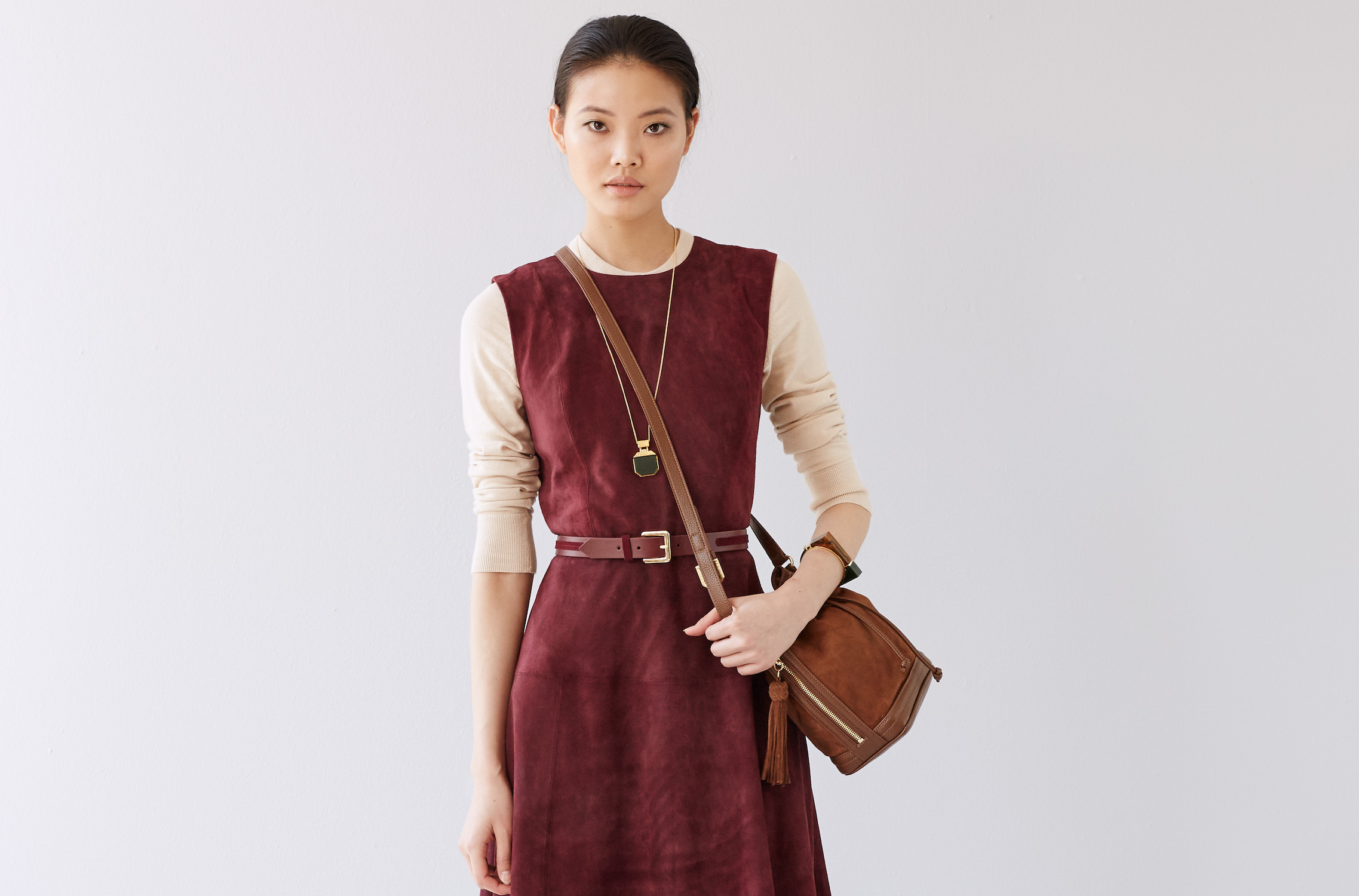 A belted suede dress that hits just above the knee over a thin T-shirt will take you from work to play (credit: ann taylor)