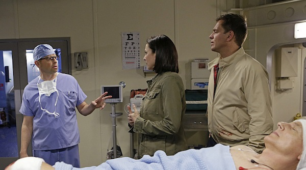 """Stop the Bleeding"" -- Gibbs fights for his life aboard a Navy hospital ship after being shot, while DiNozzo and Joanna Teague travel to Shanghai to try and take down the Calling, on the 13th season premiere of NCIS, Tuesday, Sept. 22 (8:00-9:00 PM, ET/PT), on the CBS Television Network. Jon Cryer begins a multi-episode arc as Gibbs' surgeon, Dr. Cyril Taft. Mimi Rogers returns as CIA Officer Joanna Teague. Pictured left to right: Jon Cryer, Mimi Rogers, Michael Weatherly and Mark Harmon Photo: Sonja Flemming/CBS ©2015 CBS Broadcasting, Inc. All Rights Reserved"