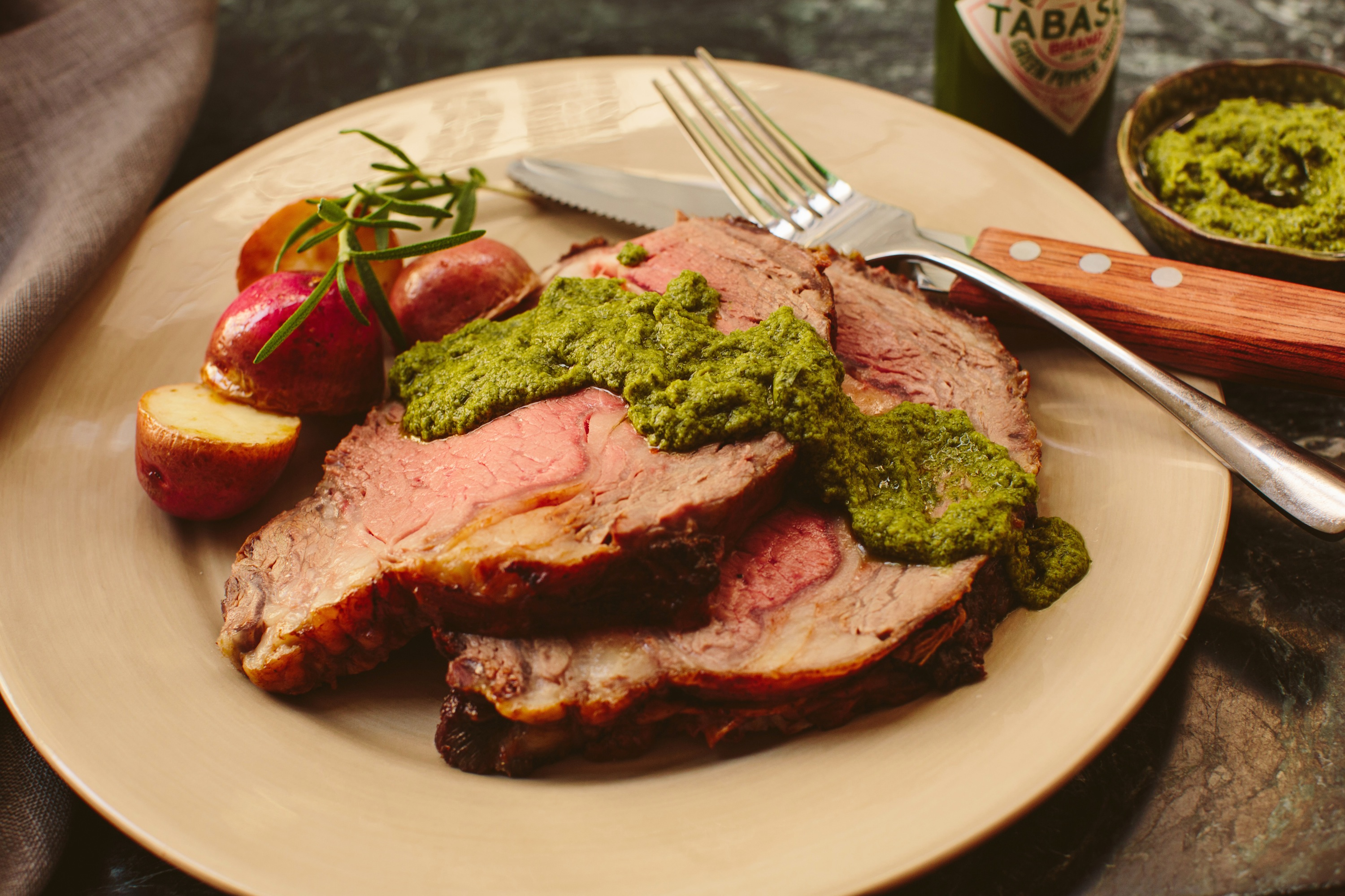 Prime Rib Roast with Salsa Verde and Red Bliss Potatoes credit: tabasco