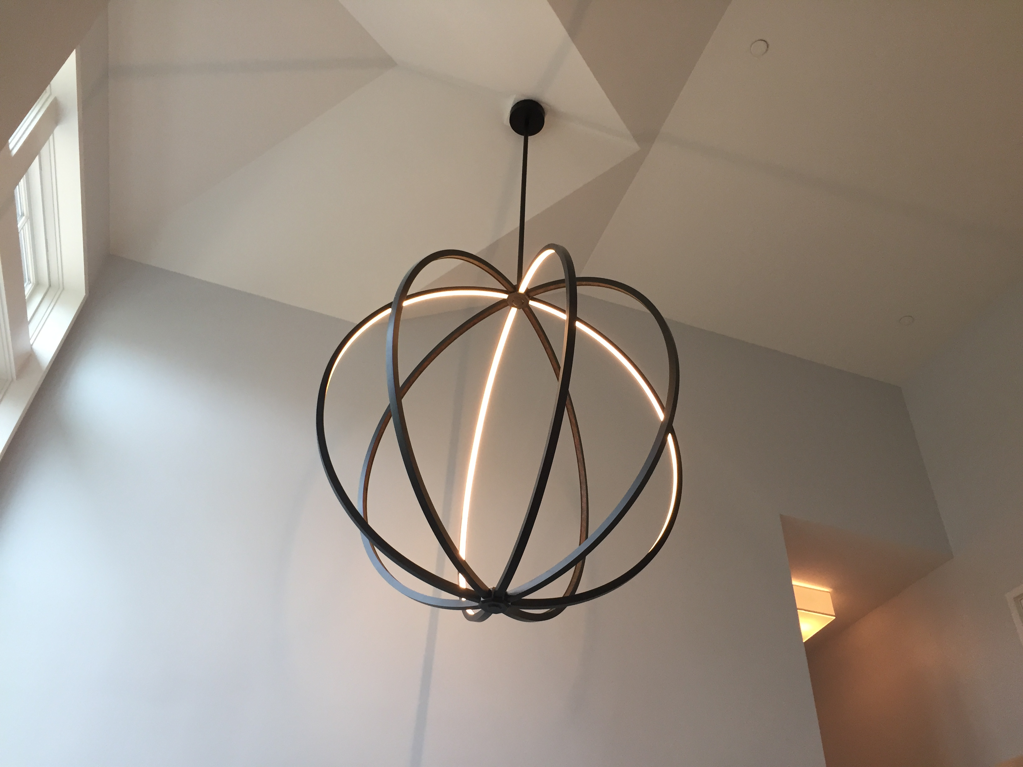 This statement chandelier uses LED lights.