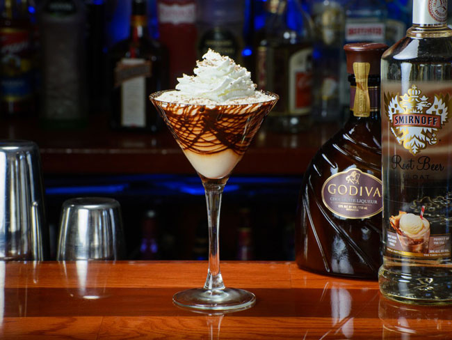 Root Beer Float Martini Ingredients: Smirnoff root beer float vodka, dark crème de cacao, Godiva chocolate, cream and whipped cream to top