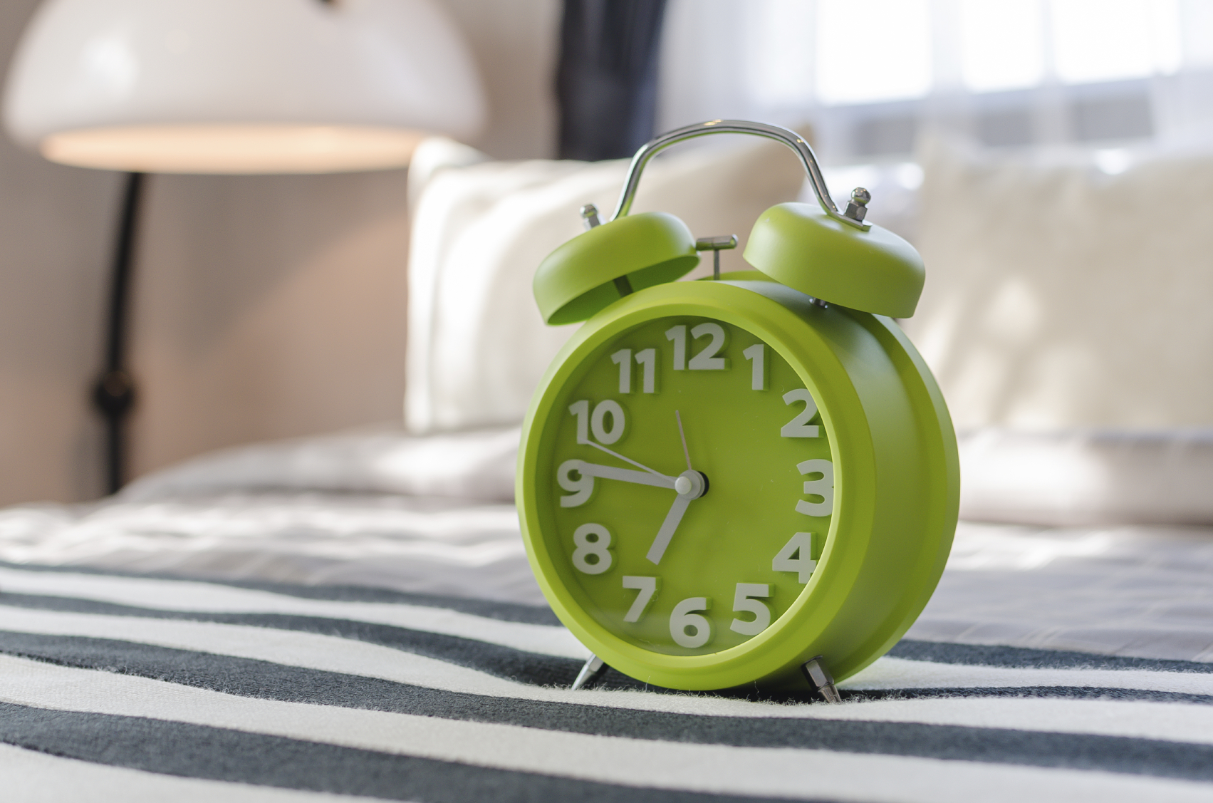 A good-old fashioned alarm clock (or your iPhone) can get you out the door on time image: khongkitwiriyachan