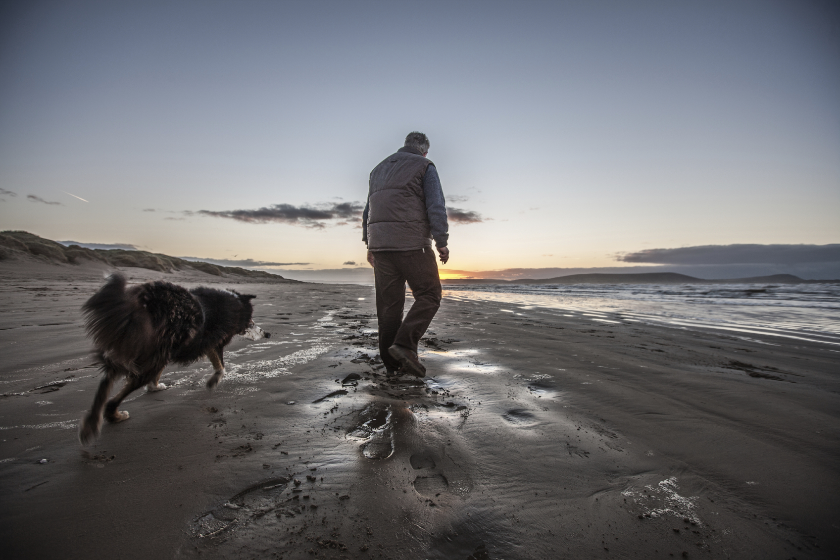 A walk on the beach with your four-legged friend may be a way of meditating image: tirc83