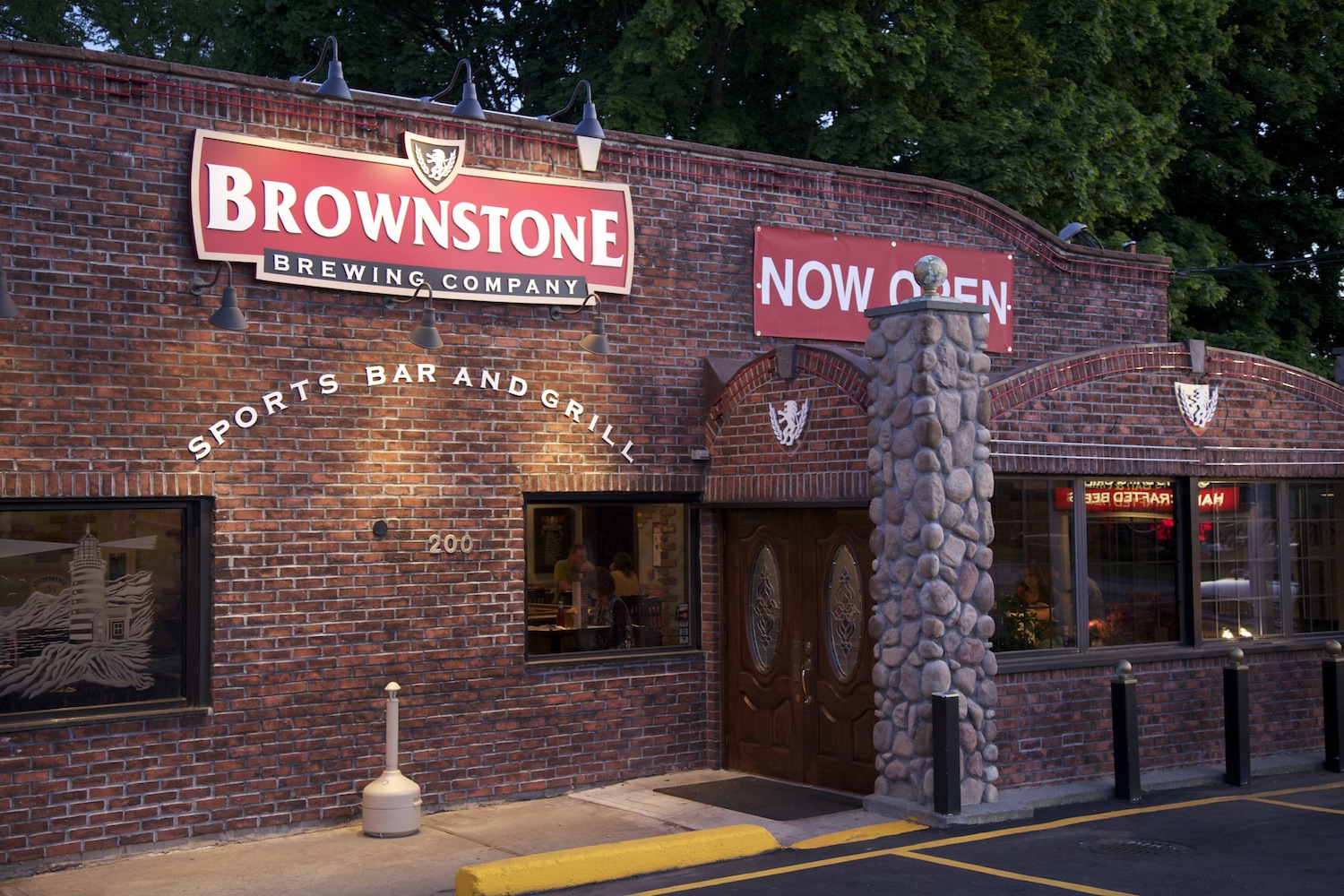 start your quest to get your name on a brick indoors on sunday image: brownstone brewery