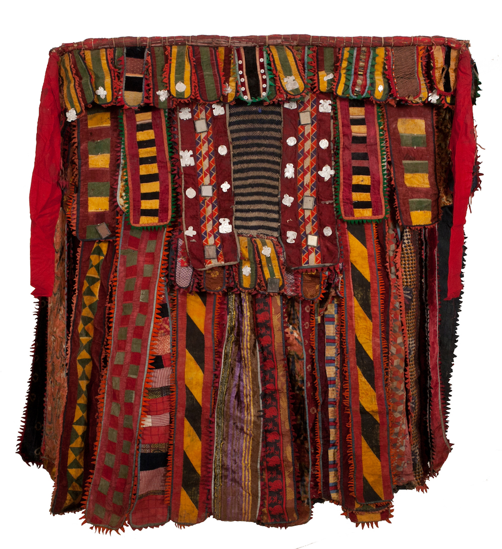 Nigeria, Yoruba peoples Egungun Masquerade Costume, 19th-20th century Fabric with strip woven dyed cotton, felt, metal coins, and mirrors 60 3/4 x 59 x 12 in. Gift of Mr. and Mrs. Sol Levitt, HU93.2