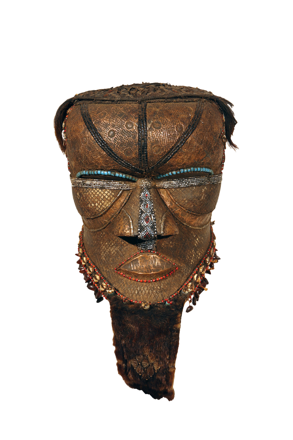 Democratic Republic of the Congo, Kuba peoples Helmet Mask (Bwoom), 19th-20th century Wood with sheet copper, cowrie shells, fur, beads, fabric, hair 17 3/4 x 11 1/4 x 18 3/4 in. Gift of Mr. and Mrs. Sol Levitt, HU96.56