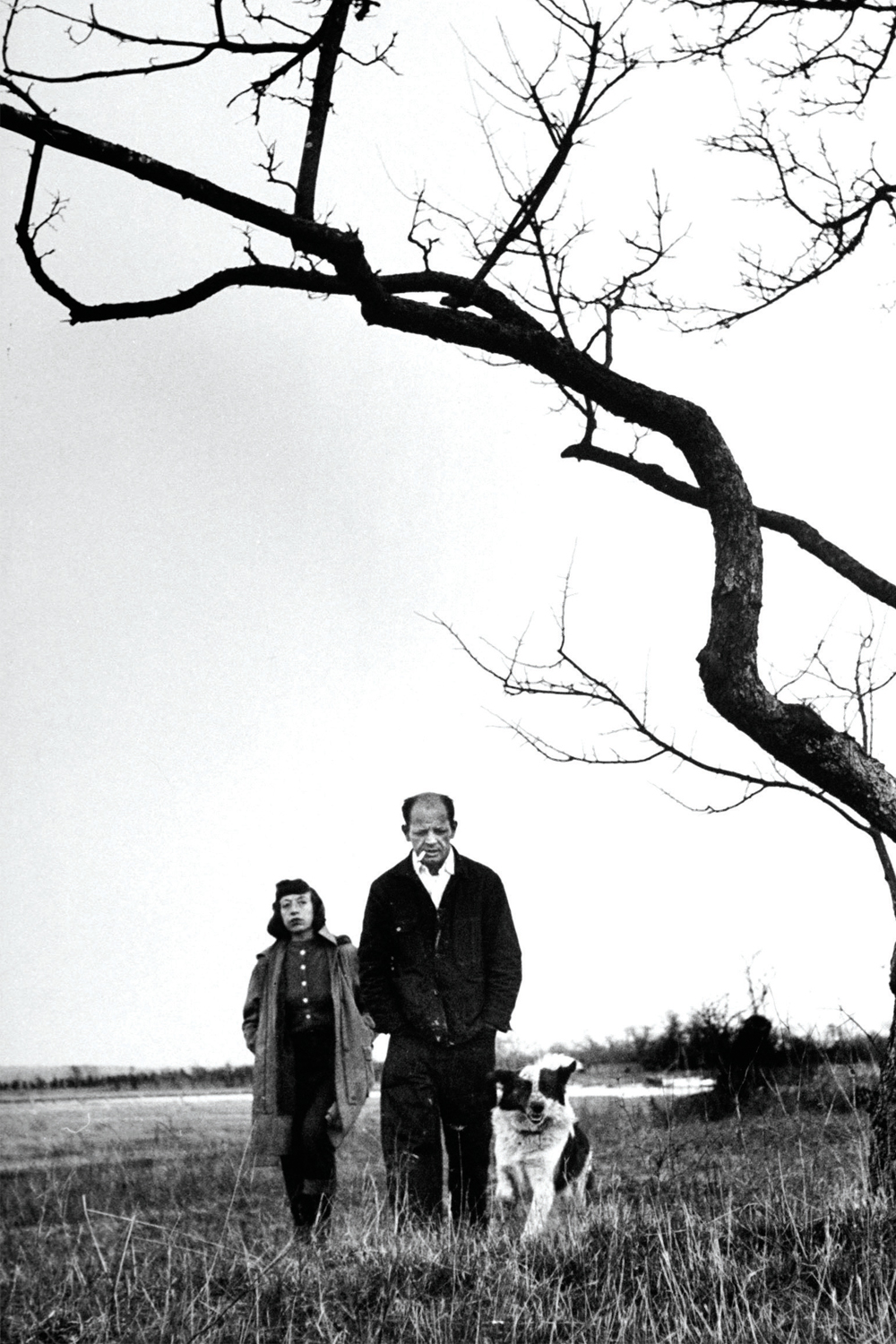 Painter Jackson Pollock (R) walking in eld with wife Lee Krasner.