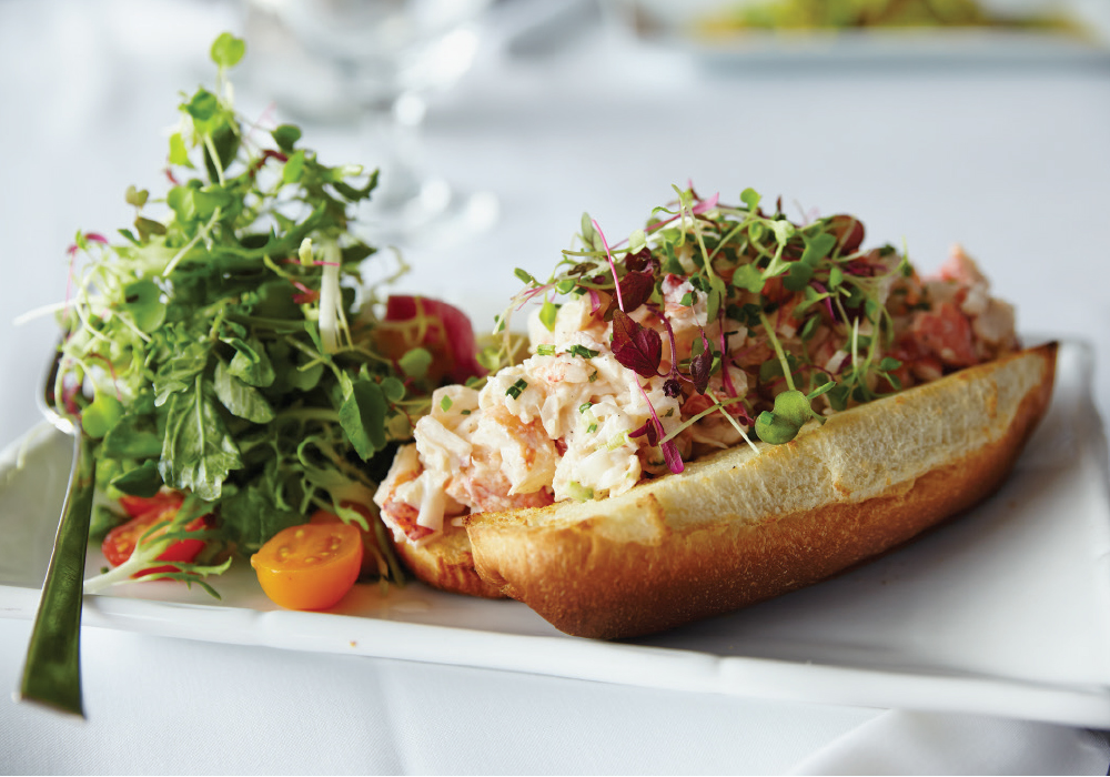 Bay Kitchen lobster roll—hand shucked lobster on toasted brioche with lemon, parsley and celery. image: YVONNE ALBINOWSKI