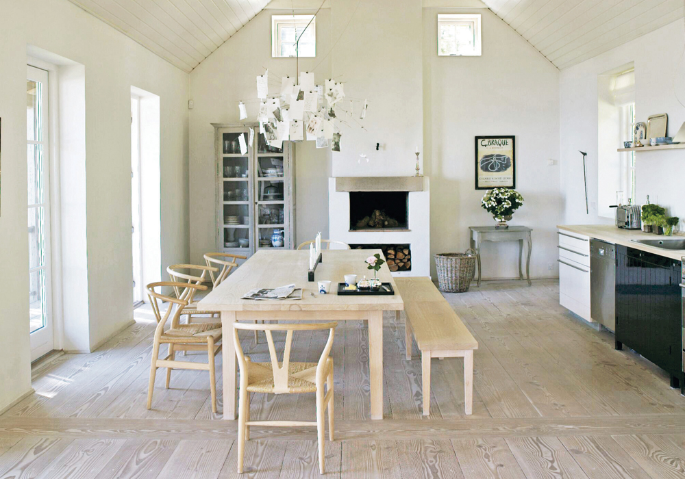 Living in countries that are dark much of the year, Scandinavians seek out light-filled interiors. Whitewashed woods, pale walls and large windows allow the sun to shine in each room.