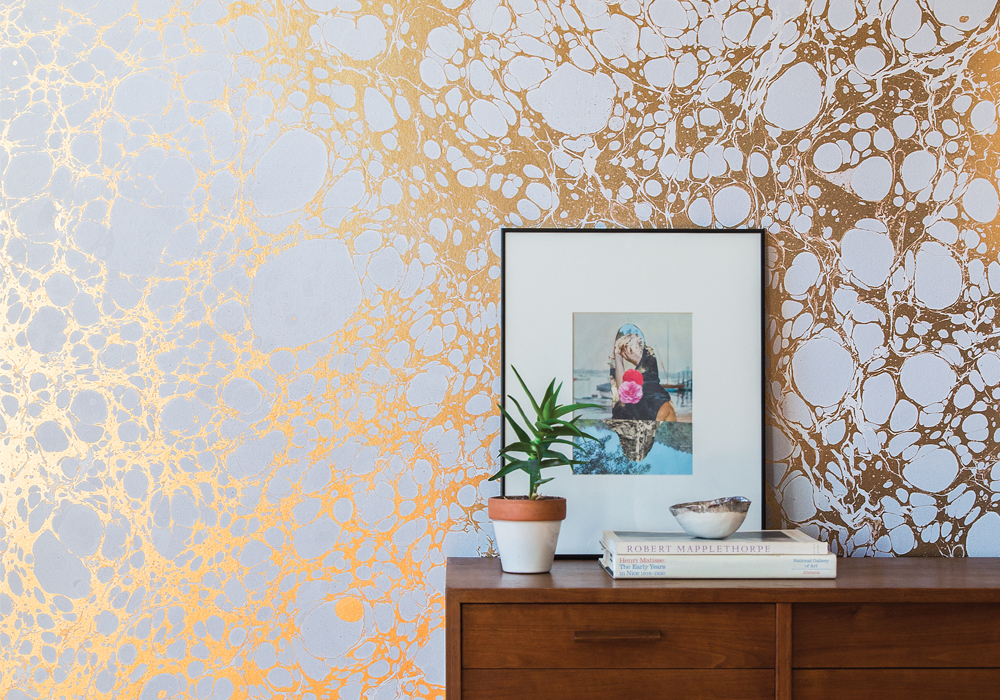 Calico Wallpaper's Wabi River creates a vertical field of gold. image: white arrow