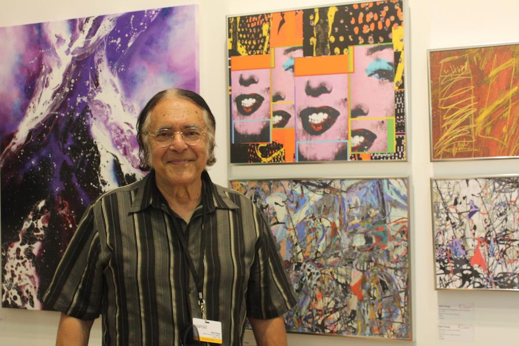 "Artist Adel Gorgy poses with his works ""Marilyn Persona – Traces of Warhol"" and ""Sonnet for Love – Traces of Pollock and de Kooning"" represented by Able Fine Art NY Gallery. Gorgy prides himself on having the guts to ""abstract abstraction"", transforming the works of famous pop artists into his own interpretations. image: elizabeth cantwell"