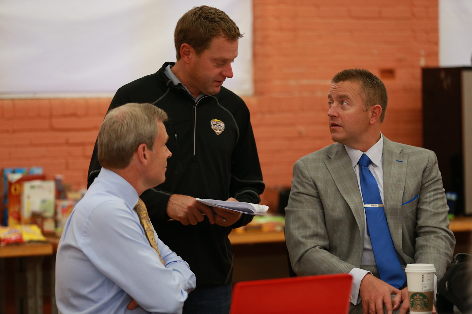 Clemson, SC - October 3, 2015 - Memorial Stadium: Tom Rinaldi, Lee Fitting and Kirk Herbstreit in the production meeting for College GameDay Built by the Home Depot image: allen key / espn images