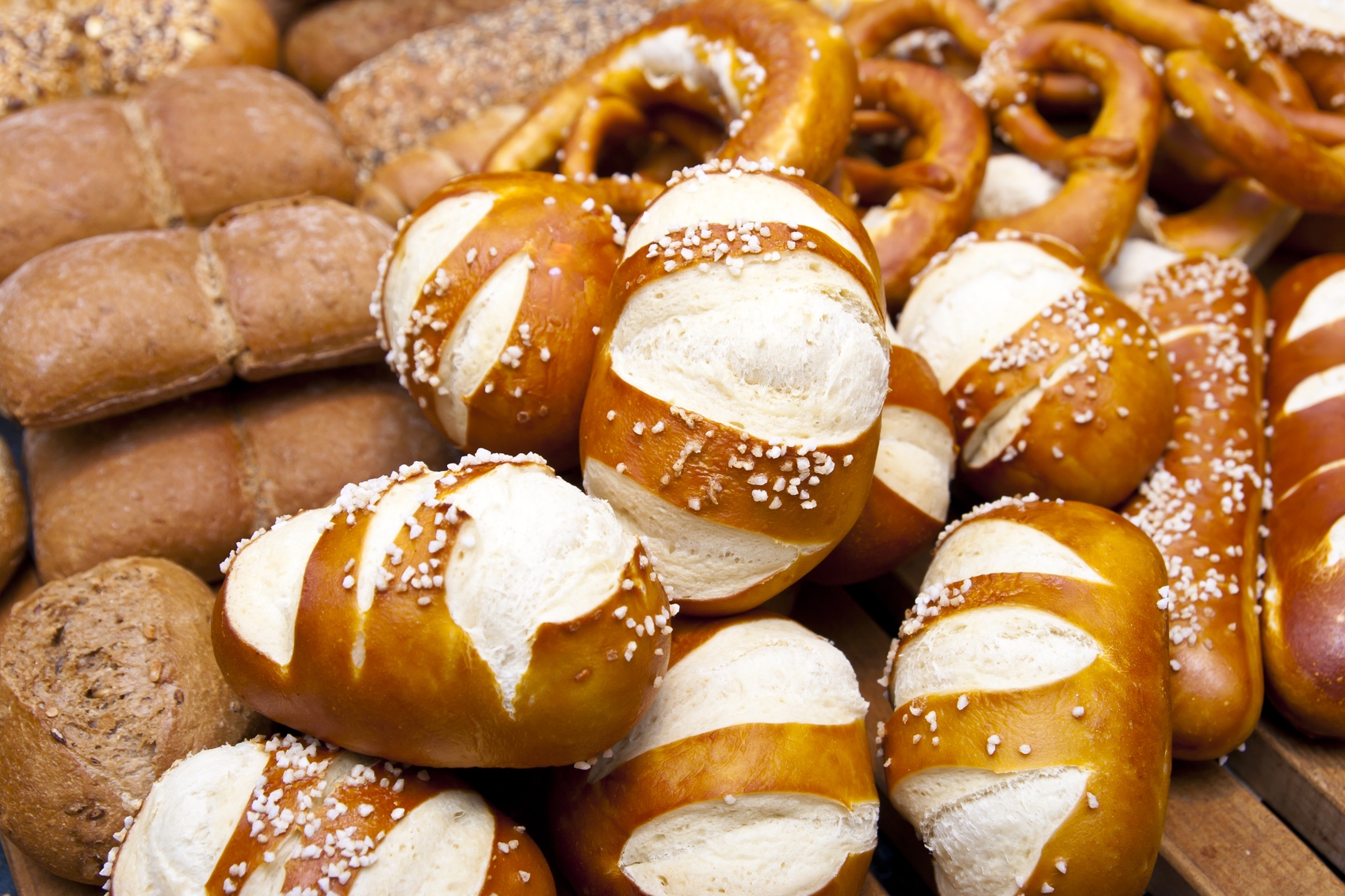 Close-up of salted lye rolls, pretzels and rye buns
