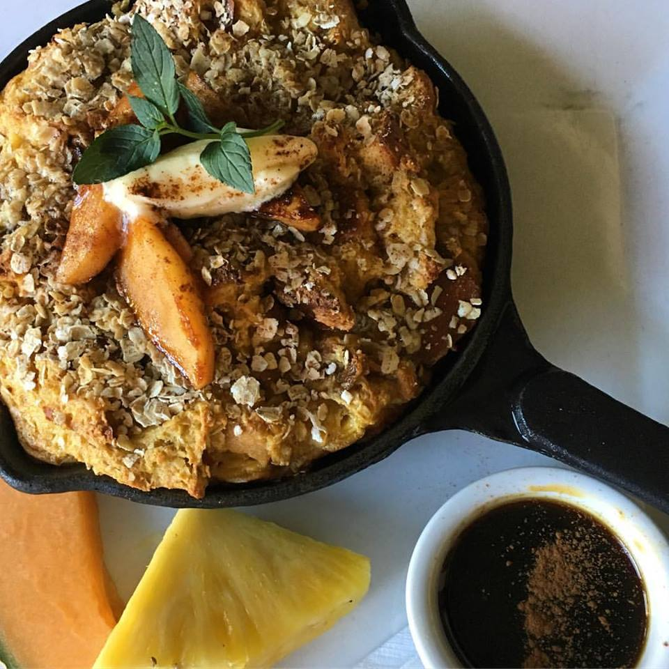 Skillet French Toast, with challah bread, toasted apples, raisins, granola crust and cinnamon maple glaze, is on the Grey Horse Tavern Sunday menu.