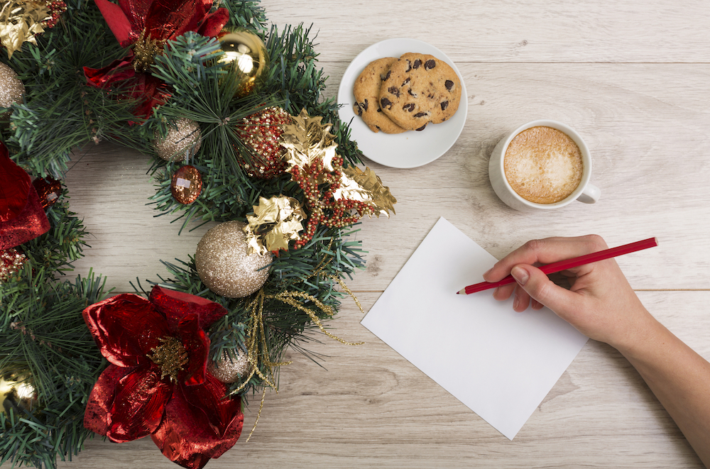 Coffee and a chocolate chip cookies with a Christmas decor on the wooden background