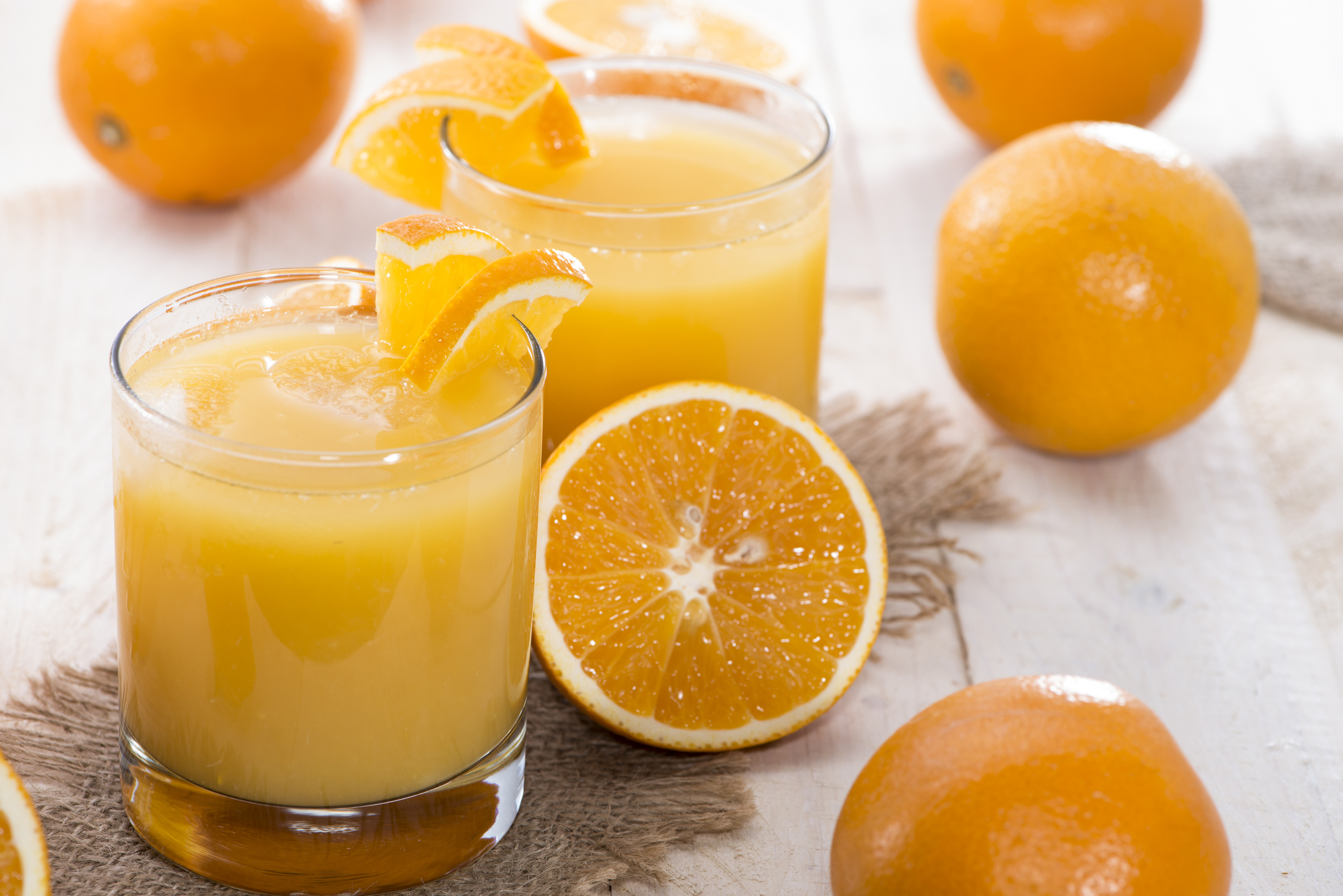Portion of fresh made Orange Juice (with fruits)