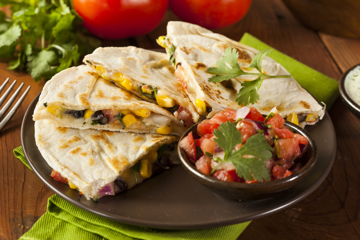 Homemade bean quesadilla with salsa and corn