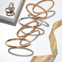 Stackable bangles and bands from the Roberto Coin Symphony Collection. All available at H.L. Gross & Bro. Jewelers, Garden City, (516) 747-6666
