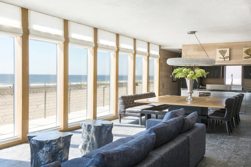 Modern yet cozy furniture invites guests to relax and let the beachside views take center stage.